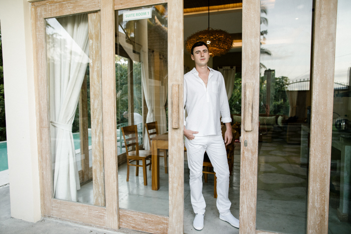 The groom opted for a casual white look with pants, a shirt and slipons