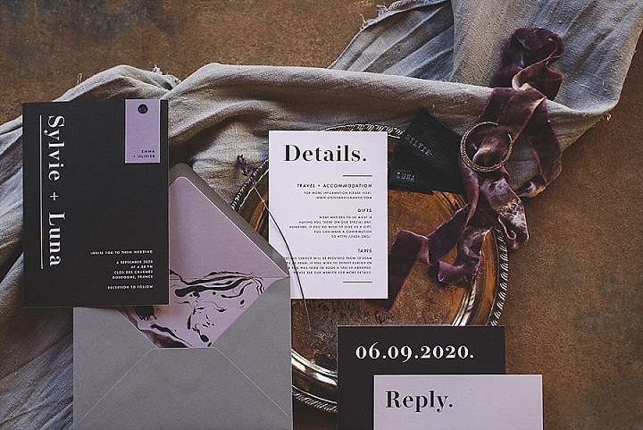The wedding stationery was done in black, grey and lilac with modern printing