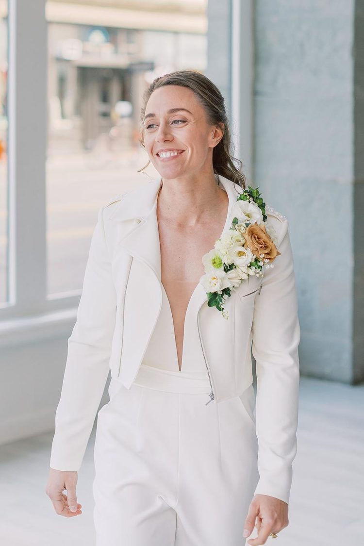 The second bride was wearing a more rock look with a white jumpsuit, a white moto jacket and a lush floral boutonniere