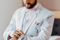 04 The second groom went for a similar suit in dove grey, with hand painted flowers and a pink bow tie