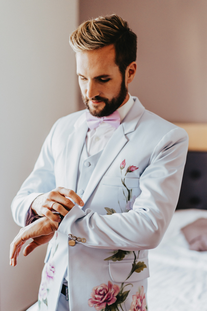 The second groom went for a similar suit in dove grey, with hand painted flowers and a pink bow tie
