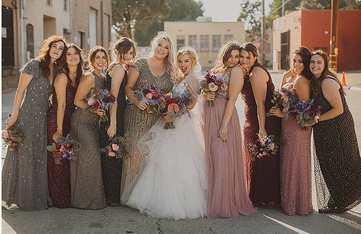 The bridesmaids were rocking mismatching fully embellished maxi dresses