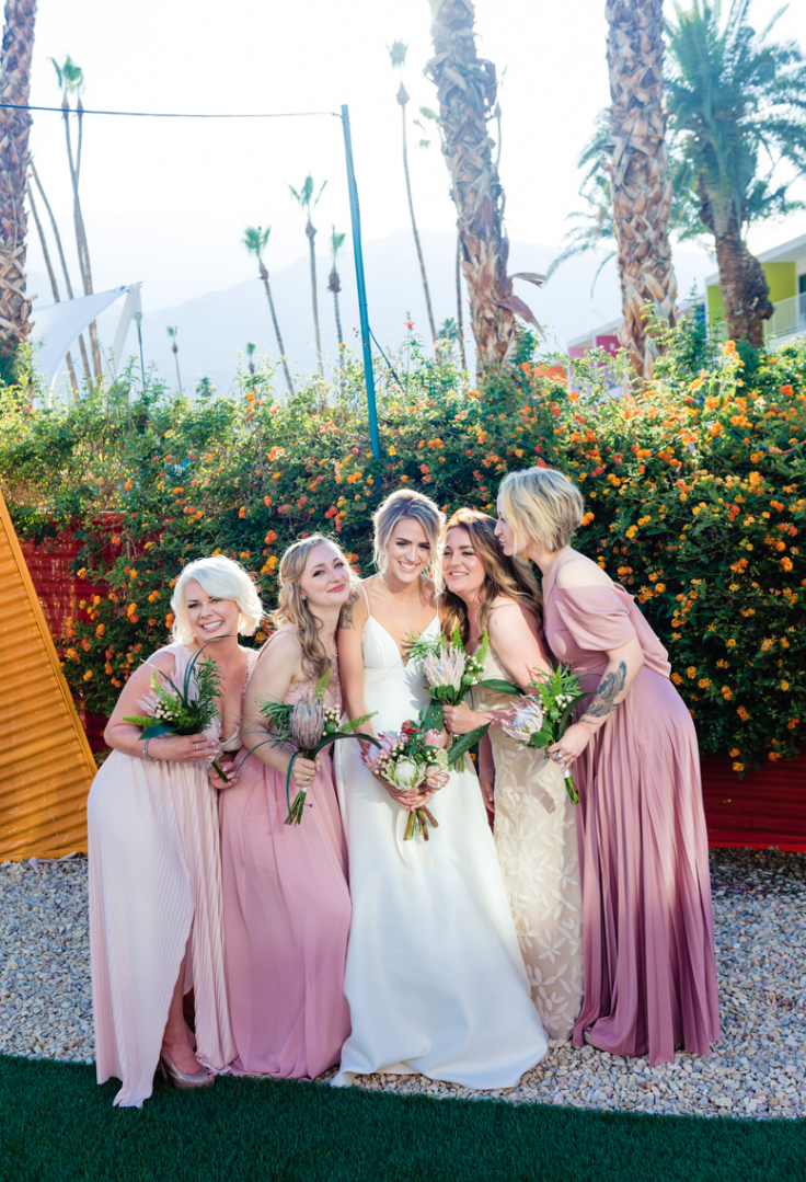 The bridesmaids were wearing mismatching pink maxi dresses
