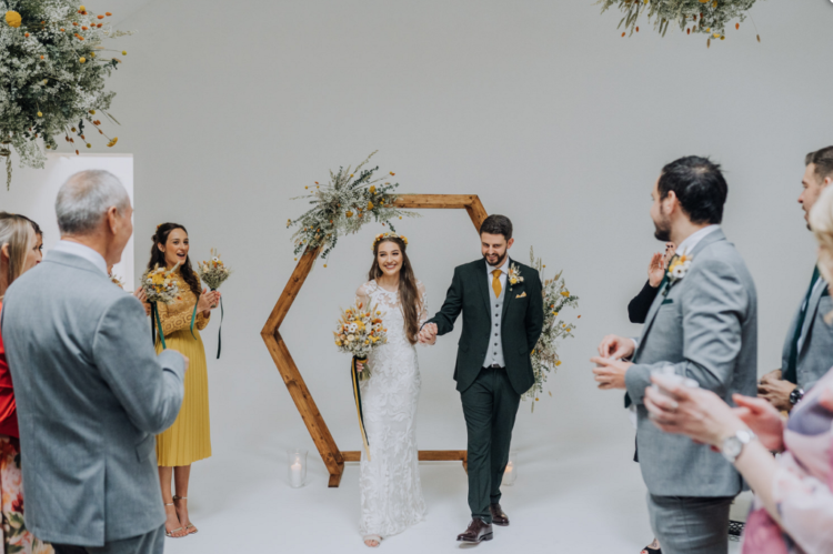The wedding arch was hexagonal and it was built by the father of the bride
