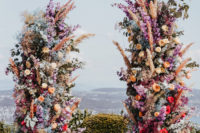 an awesome floral wedding arch