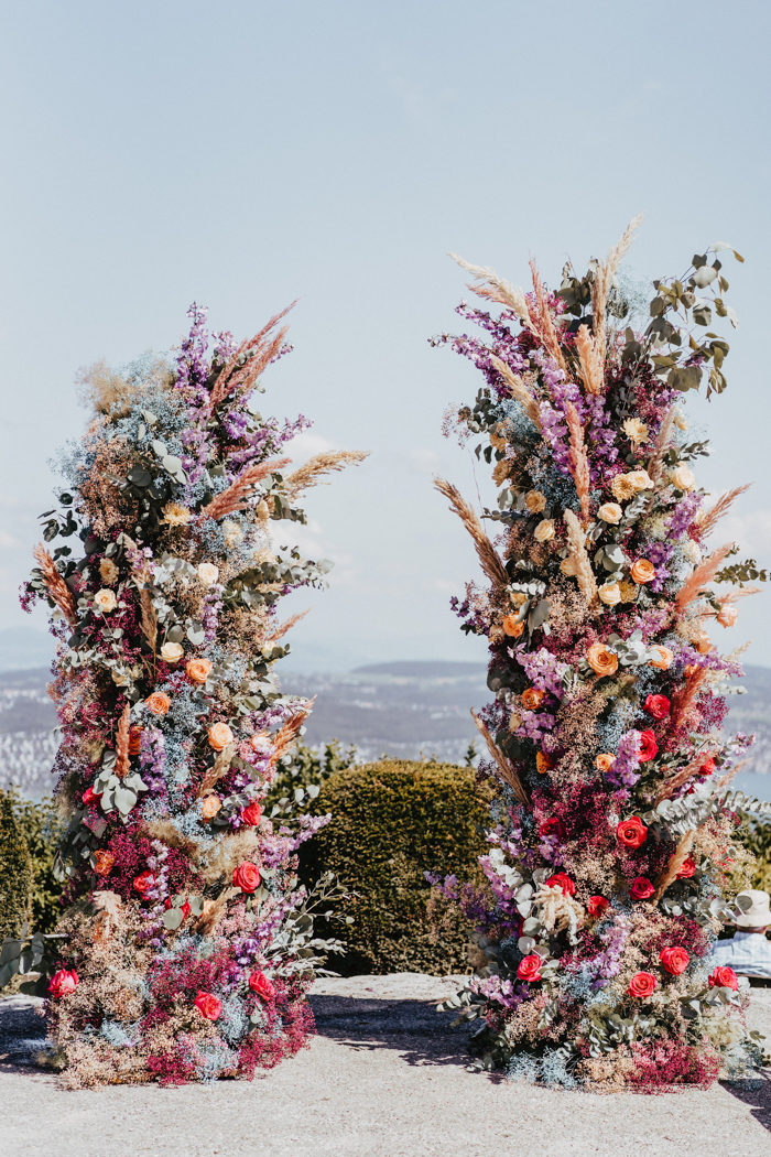 There was an incredible lush colorful floral wedding altar with a gorgeous view of Zurich