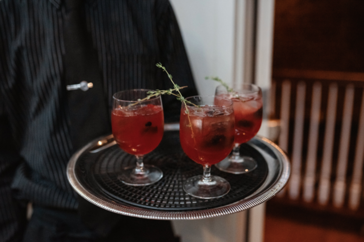 Delicious cocktails were styled for this dark-themed wedding