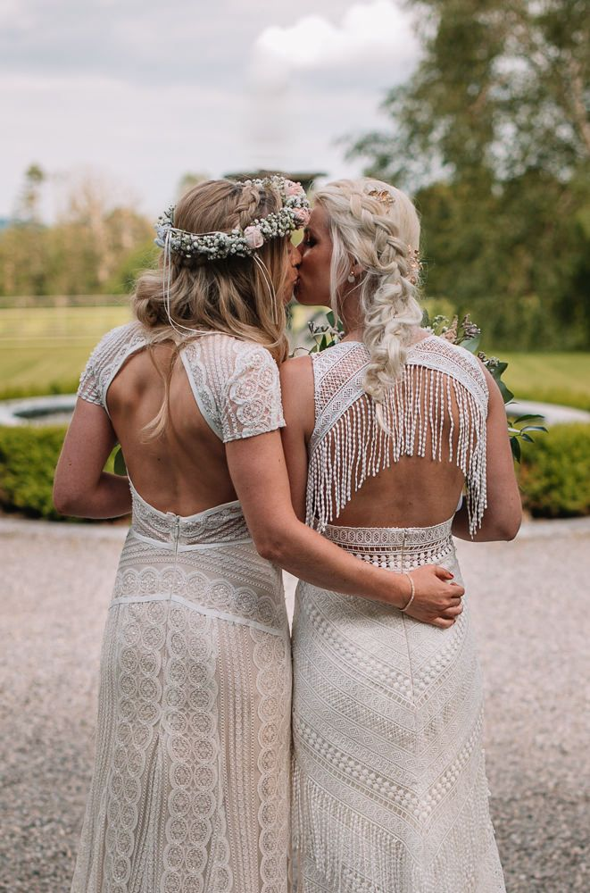 One bride was wearing a boho fishtail braid and the second preferred a braided half updo