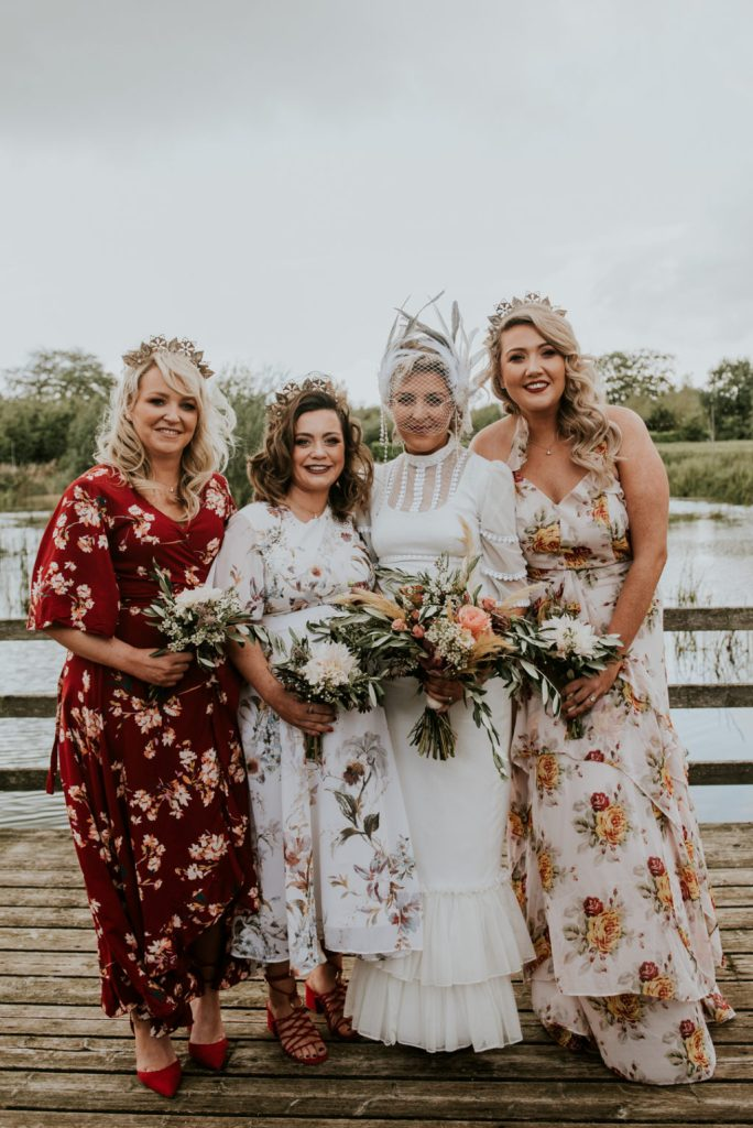 The bridesmaids were wearing bold mismatching floral print dresses and red shoes