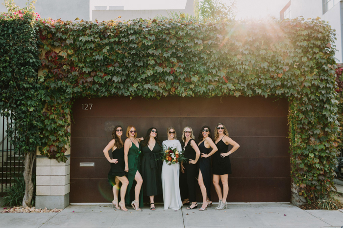 The bridesmaids were wearing mismatching black, green and hunter green dresses