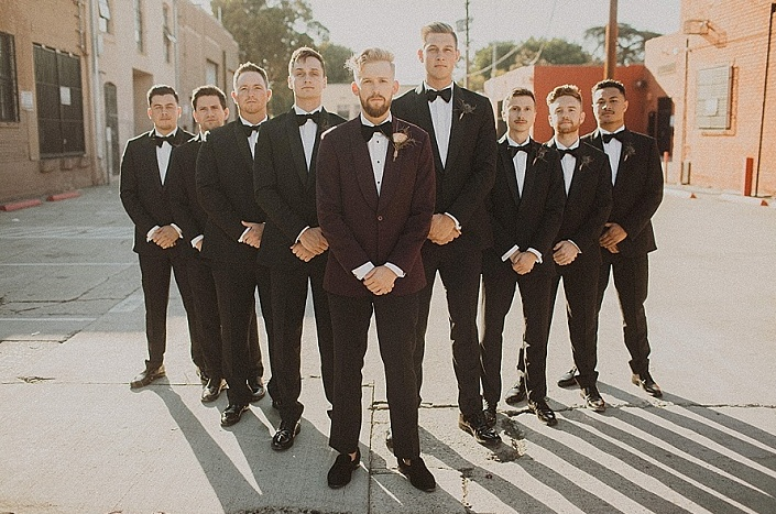 The broom was wearing a burgundy tux, and the groomsmen were rocking black ones