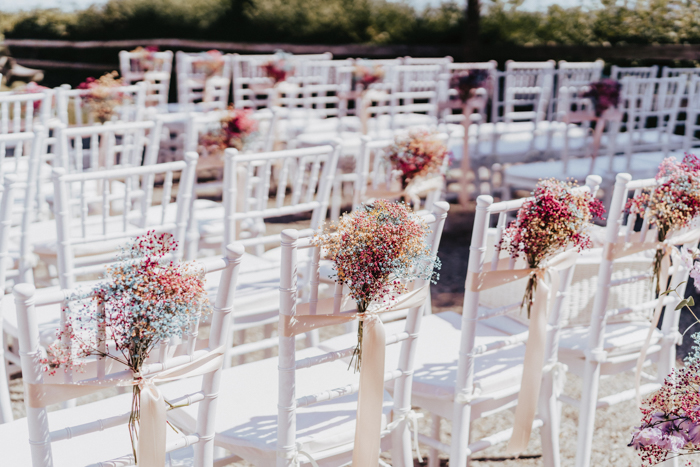 The chairs were accented with bright blooms, too