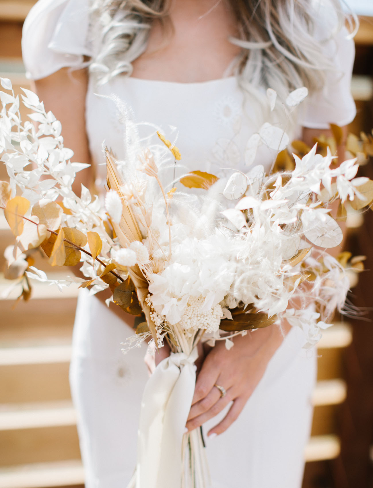 The wedding bouquet was composed of dried blooms and foliage
