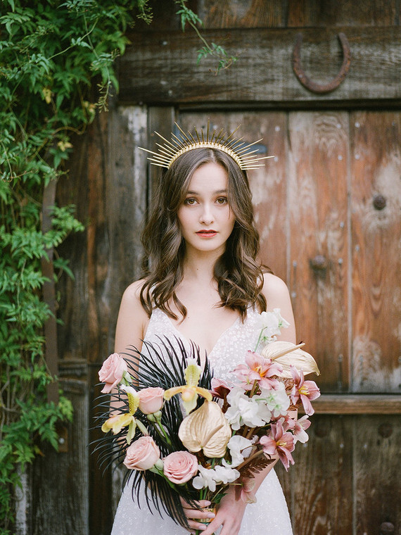 The wedding bouquet was done with blush blooms, blackened fronds and gilded flowers