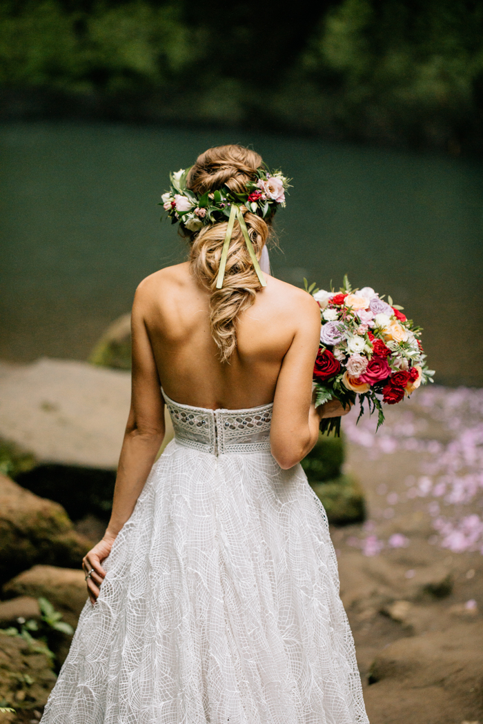 The wedding hairstyle was a twisted half updo with a floral crown