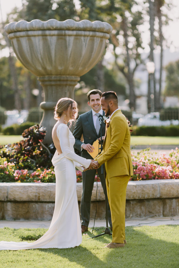 The groom was wearing a cool mustard wedding suit and looked wow