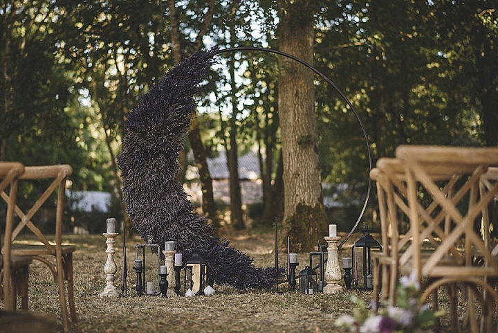 an interesting round wedding arch