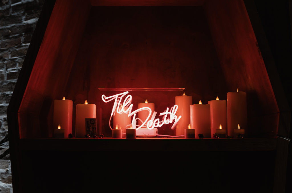 The wedding decor was done with neon and candles, not a single bloom