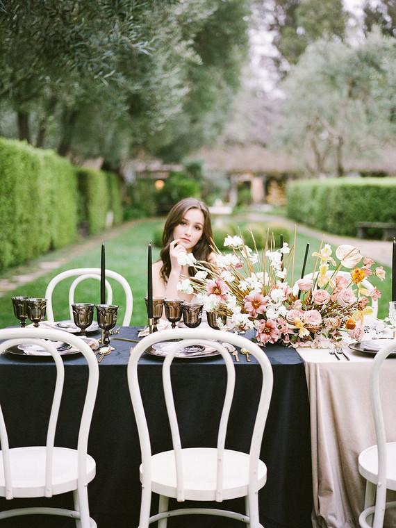 Black glasses, black candles and a lush pink and gold centerpiece finished off the tablescape