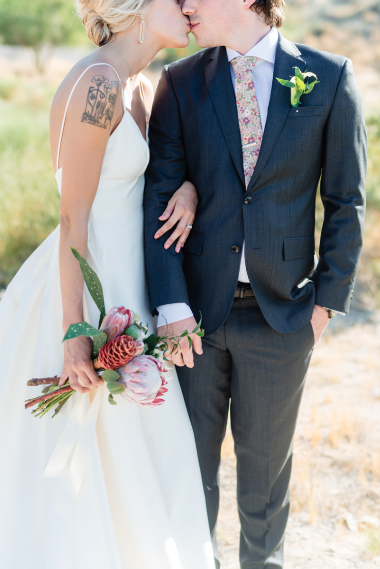 I love the grooms' floral tie and a king protea wedding bouquet