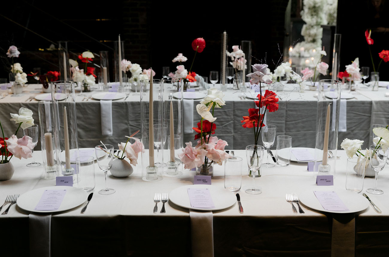 Pink, red and purple spruced up the strict all white tablescapes