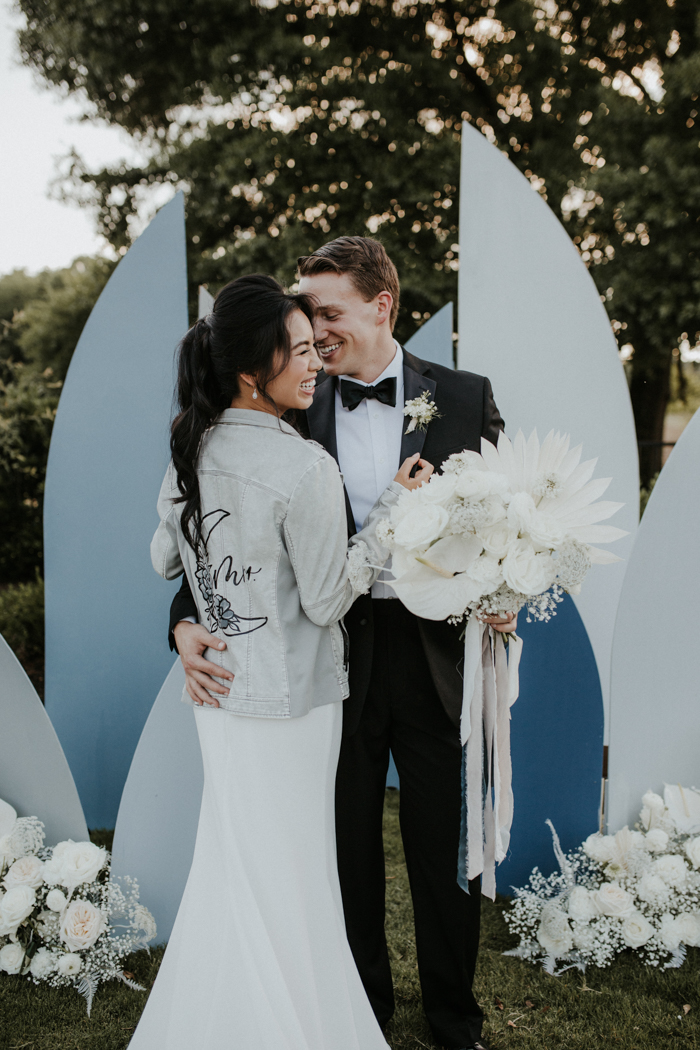 The bride rocked a bleached denim jacket personalized for her