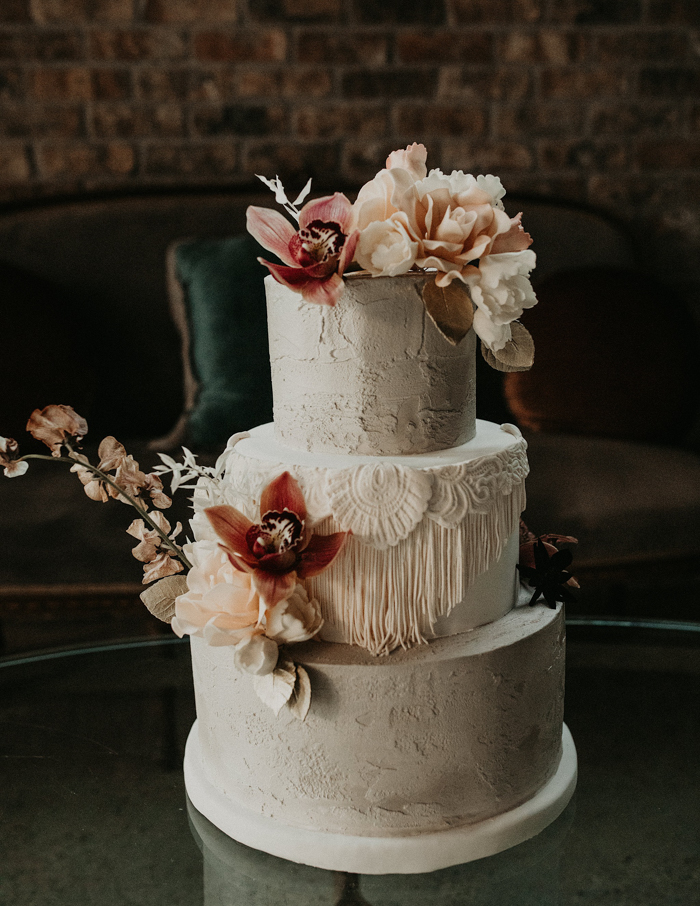 The wedding cake was a white textural one, with macrame and blush and bold blooms