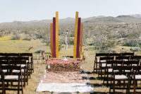 08 The wedding ceremony space was done with layered rugs, candles and colorful decor plus candlesticks