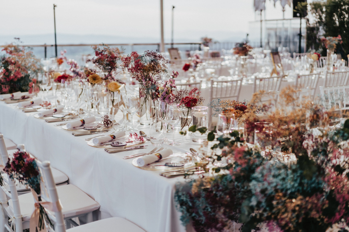 The wedding reception was done with bright and lush florals and greenery