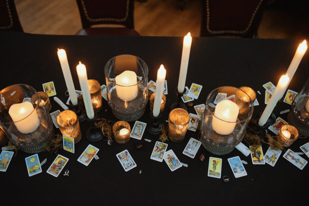 The wedding tablescape was done with lots of different candles, tarot cards and some moss