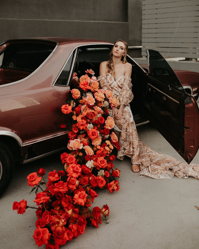The car was decorated with a whole arrangement of bold blooms with an ombre effect
