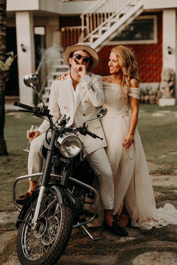 The couple enjoyed riding a bike after their wedding