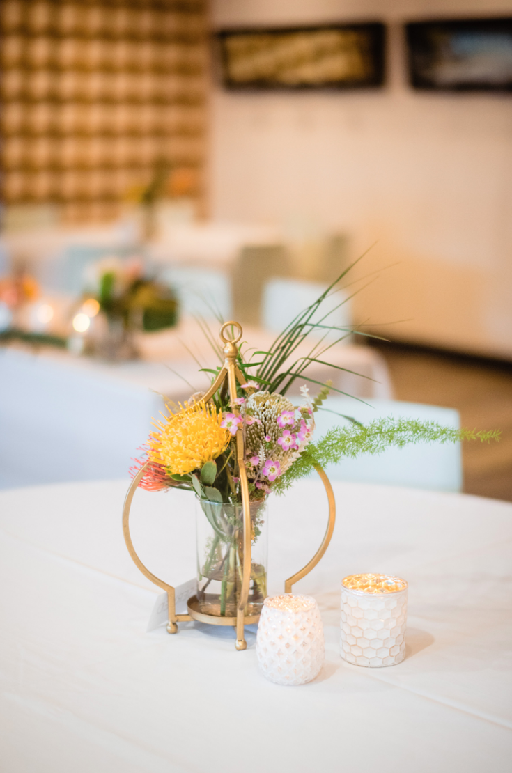 The wedding centerpieces were done super bright, with greenery and brass