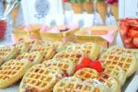 09 a small waffle bar with heart-shaped waffles, bright blooms, wooden baskets, berries and fruits