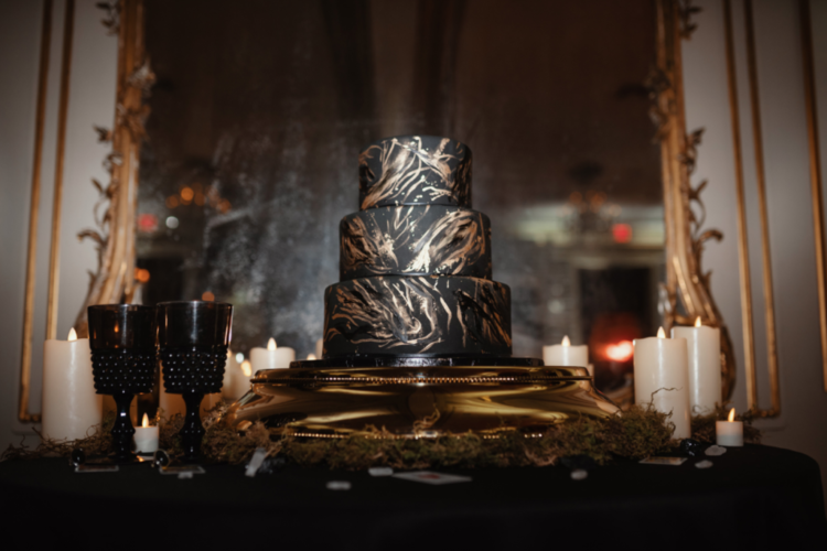 The wedding cake was a black one decorated with gold brushstrokes