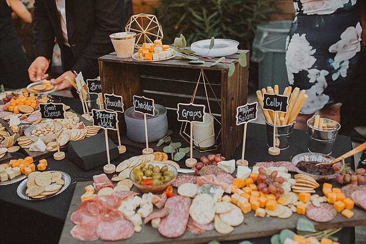 There was a grazing table, too, decorated with greenery and chalkboard tags
