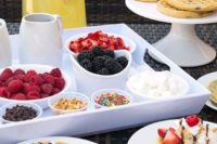 10 a small waffle bar with waffles, berries, various toppings and fresh lemonade is a cool idea for a modern wedding