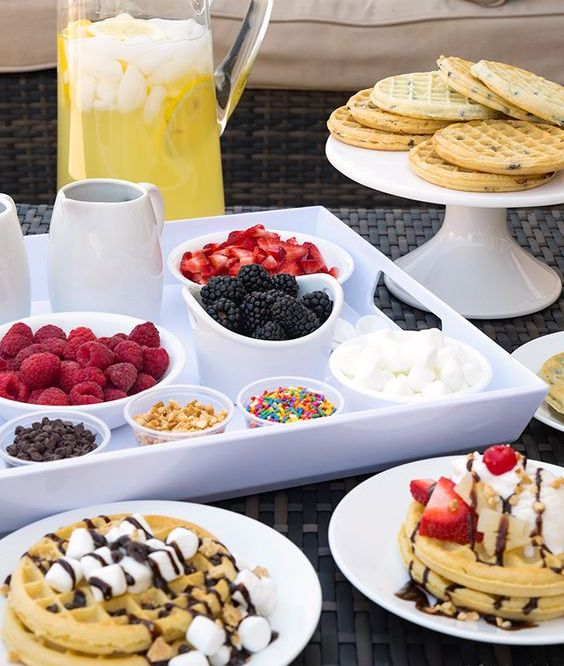 a small waffle bar with waffles, berries, various toppings and fresh lemonade is a cool idea for a modern wedding