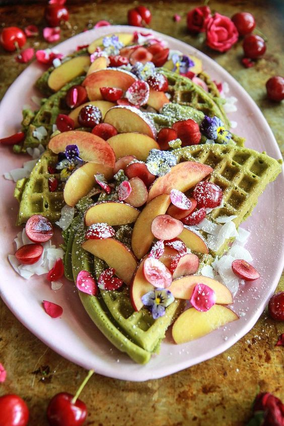 matcha waffles with edible blooms, petals, peach slices and cherries are lovely and delicious