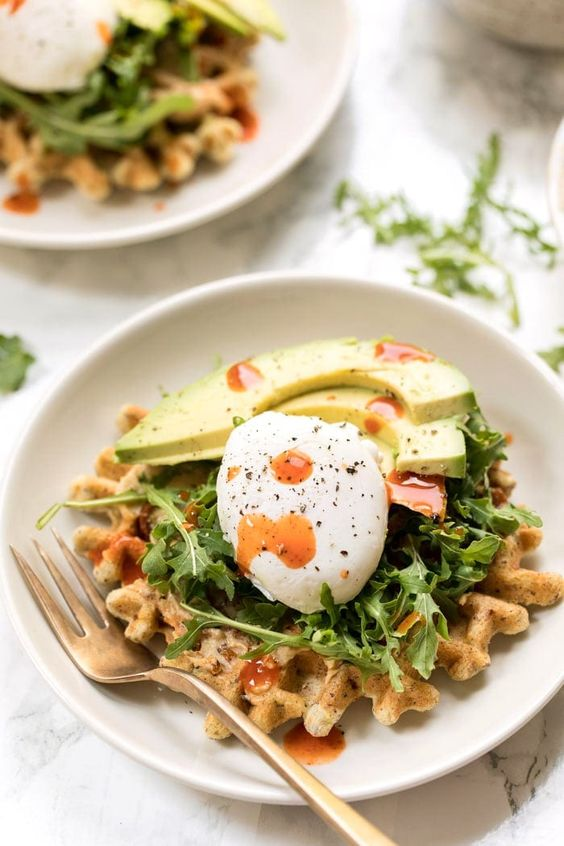 waffles with arugula, eggs, avocados and some sauce are amazing for a breakfast wedding