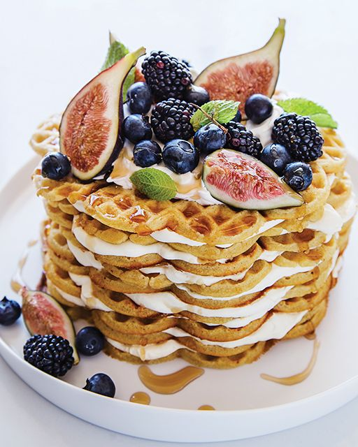a cardamom waffle wedding cake with caramel, figs, fall berries and mint is a fantastic dessert