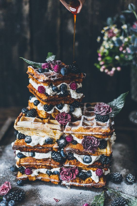 a gorgeous summer boho waffle wedding cake with blueberries and blackberries plus purple blooms and some caramel