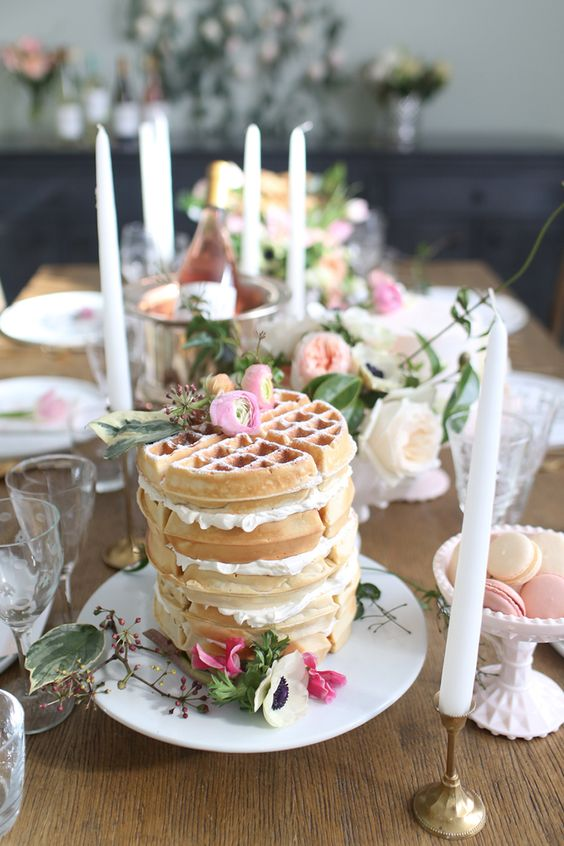 a small yet chic waffle wedding cake with pink blooms on top is very cool for a spring or summer wedding