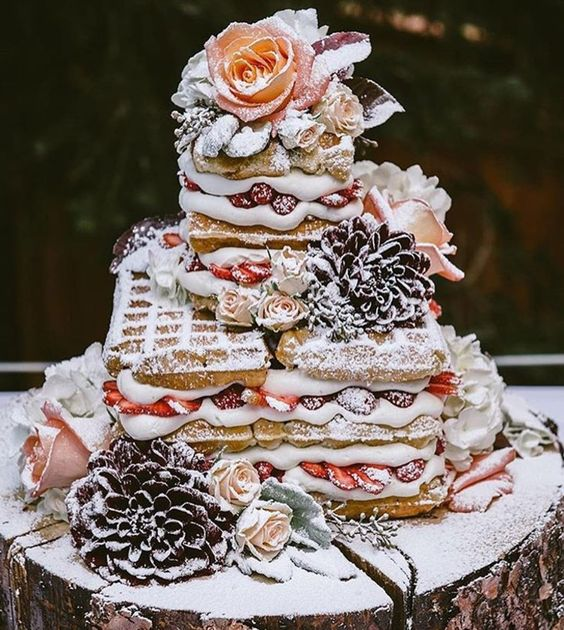 a yummy waffle wedding cake with fresh berries, blooms and sugar powder is very lovely