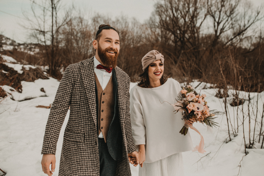 This snowy wedding shoot took place in the Italian mountains and showed off a cool and non typical color palette