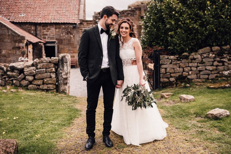 The bride was wearing a creative lace A-line wedding dress with a crop top covered with lace and a maxi skirt