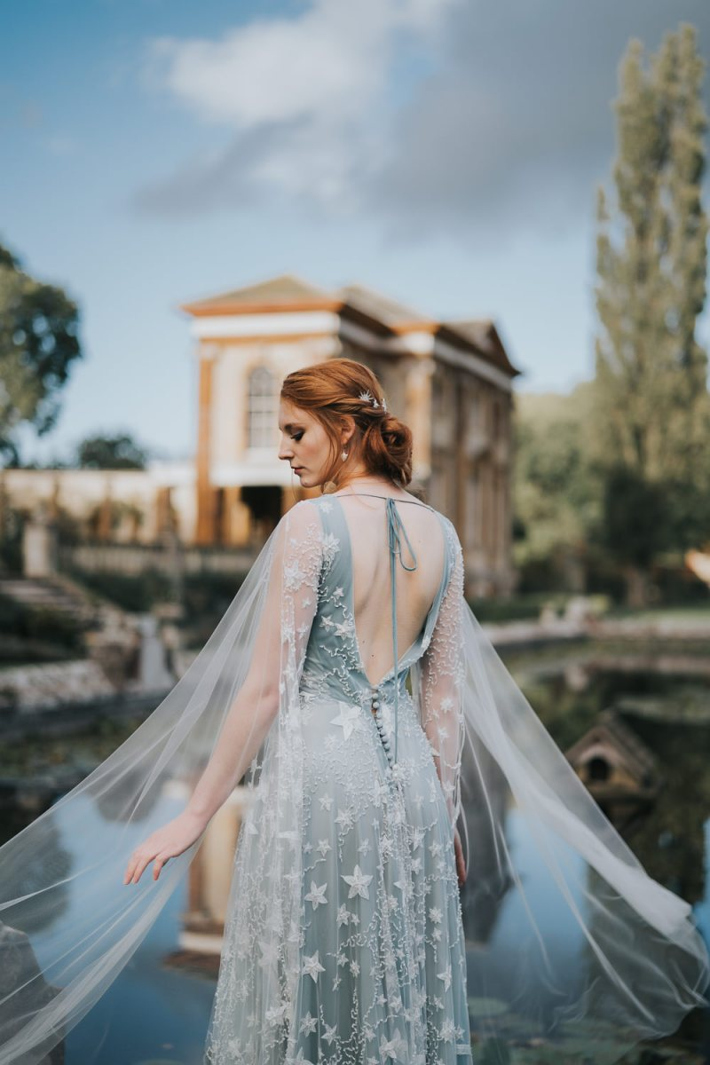 The first wedding dress was a pale blue one, with star embroidery, an open back and a capelet