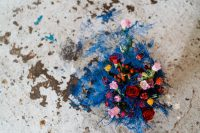 02 The wedding bouquet was done with super bright blooms of all colors, with berries and blue leaves