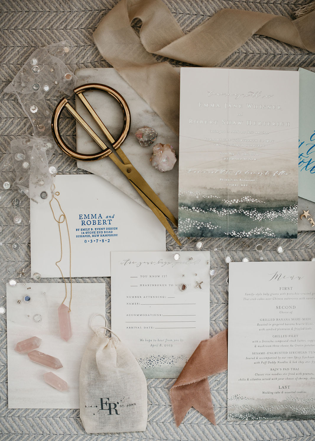 The wedding invitation suite was also iridescent and silver infused