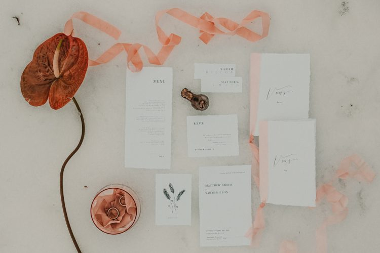 The wedding stationery was done with simple printing, blush and coral touches to contrast the snow